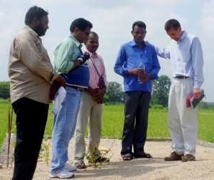 Praying for blessing & that God would provide resources to build at Pastor Phillip's new church ground.  L to R: Pastor Gabriel, Pastor Paulus Thalathodi, Pastor Prasad, Pastor Phillip, Pastor Mike Derstine